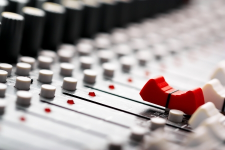 Sound mixer, red fader ahead photo