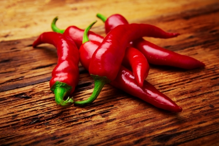 some chili peppers on a table photo
