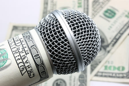 Professional vocal microphone against money photo
