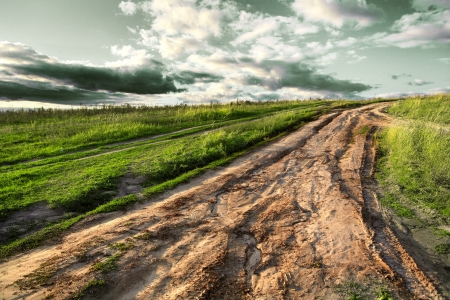 horizon over land: The road and sunset in the village
