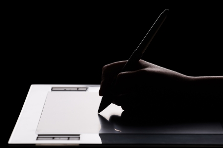 Graphic tablet, hand and feather