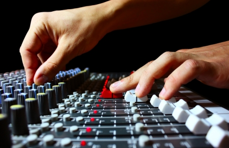 Hand on a mixer, operating the leader