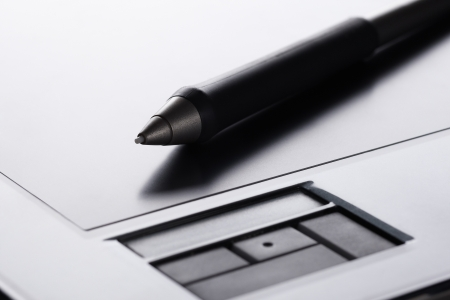 Grip pen on graphic tablet Stock Photo