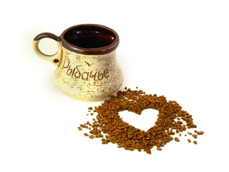 percolate: Instant coffee in the form of heart, a cup beside