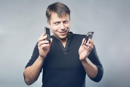Man with broken mobile phone in hands