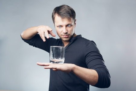 fortune telling: Hypnotist with glass on hand