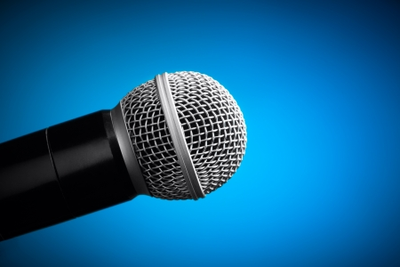 shure: Professional microphone on blue background Stock Photo
