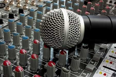 Professional vocal microphone on the mixer board