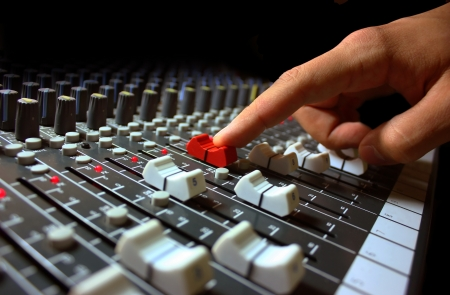 mixing: Hand on a mixer, operating the leader
