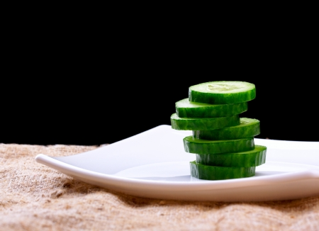 the cut cucumber on a plate photo
