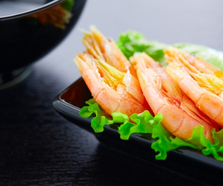 Shrimps and salad on a plate photo