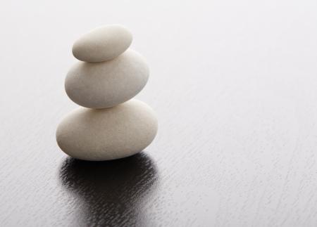 Zen stones on a wooden table Stock Photo - 17820376