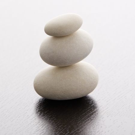 stone pile: Zen stones on a wooden table