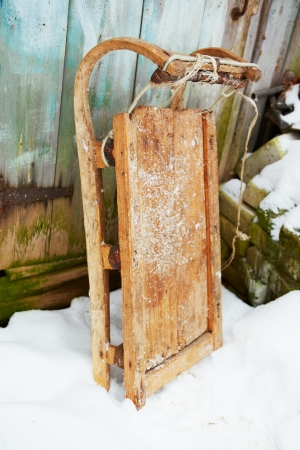 Vintage wooden sledge on snow