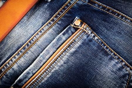 denim: Jeans con cintur�n de fondo Foto de archivo