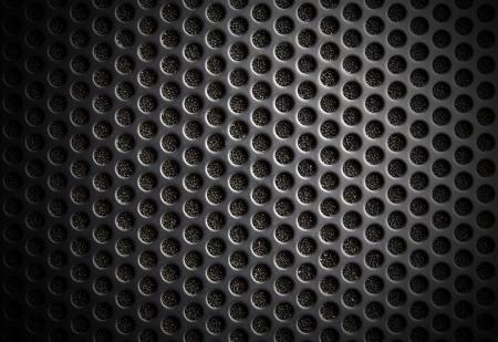 Black speaker lattice background, close-up photo