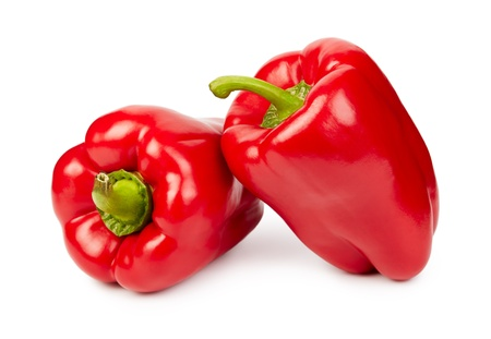 Two ripe red peppers isolated on white photo