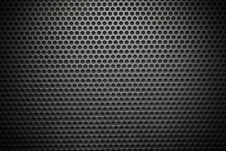 malla metalica: Altavoz negro enrejado fondo, primer plano Foto de archivo