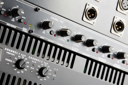 Power amplifier and equalizer control panel close-up