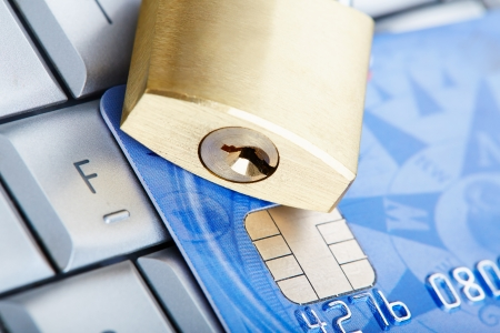 online safety: The padlock on a credit card lie on keyboard