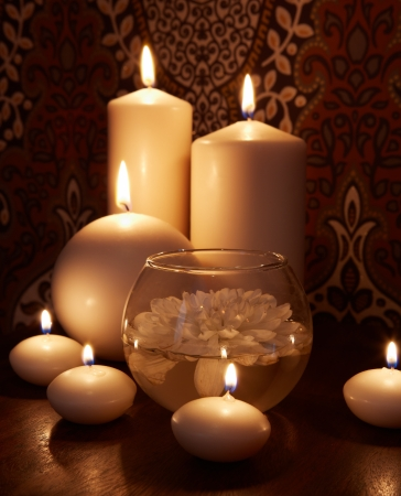 Some burning candles of the different size Stock Photo