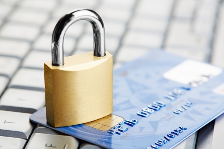 The padlock on a credit card lie on keyboard photo