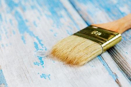 Paintbrush on wood planks close-up