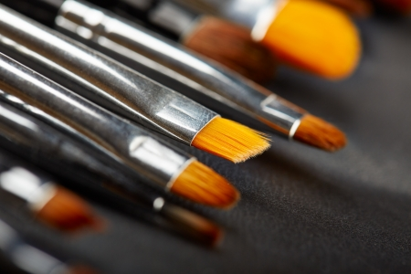 medium close up: Set of cosmetic brushes in a black leather case