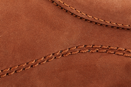 chamois leather: Suede surface of a boot with stitches