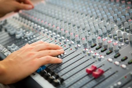 Sound engineer works with sound mixer, hands close-up Zdjęcie Seryjne
