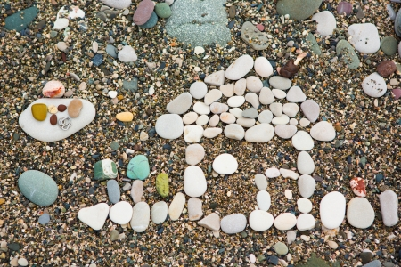 The house which has been laid out from pebble on a beach photo