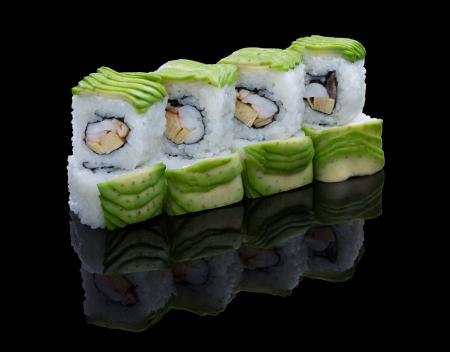 Sushi set with avocado on black background Stock Photo