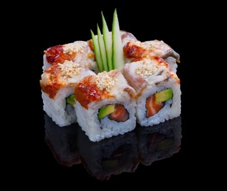 Sushi set with avocado, salmon and eel  on black background