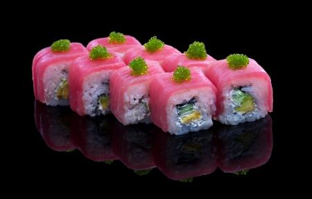 Sushi set with avocado, tuna and tobiko on black background Standard-Bild
