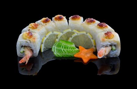 Sushi set with shrimp, cucumber and dough on black background Stock Photo