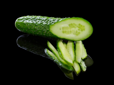 Sliced Cucumber isolated on black Stock Photo