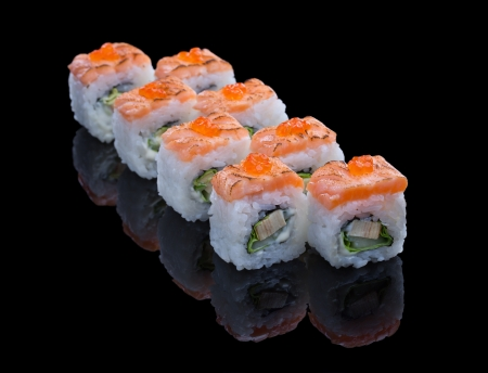Sushi set with salmon and omelet on black  Stock Photo