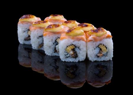 Baked sushi set with salmon, eel and omelet on black  Standard-Bild
