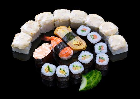 nigiri: Sushi set allsorts on black background