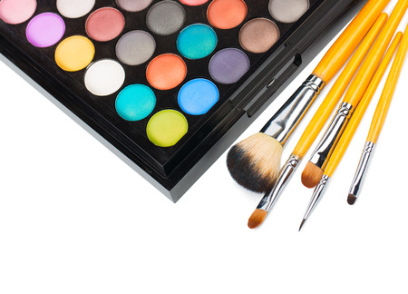 Eyeshadow makeup palette with brush isolated on white