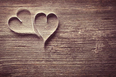 love abstract: Two paper hearts on wooden background