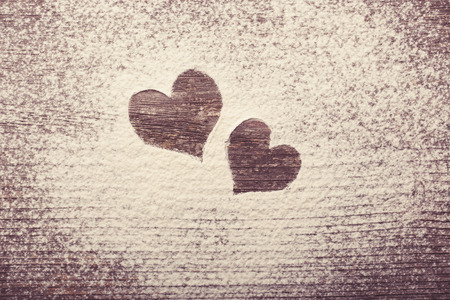 heart symbol: Two Hearts shape silhouette made from snow with copyspace