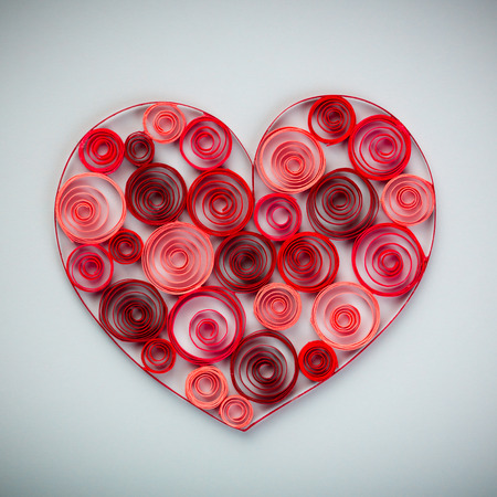 quilling: Heart of paper quilling on gray background