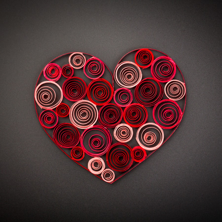 quilling: Heart of paper quilling on black background