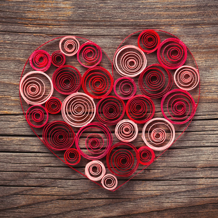 quilling: Heart of paper quilling on wooden background Stock Photo