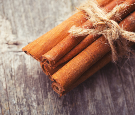 cinnamon bark: Cinnamon bark on wooden table, close-up