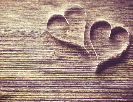 Two paper hearts on wooden background with copyspace photo