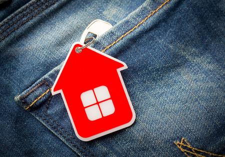 House key in jeans pocket, close-up Standard-Bild