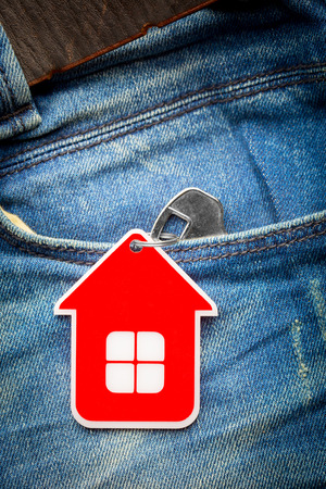 House key in jeans pocket, close-up photo
