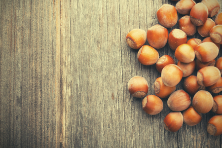 tree nuts: Hazelnuts on wood table with copyspace Stock Photo